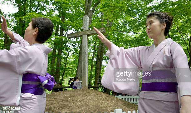 AOMORI Japan Women wearing kimono dance a Japanese traditional bon dance in a circle around a cross erected on a turf which local people believe is...