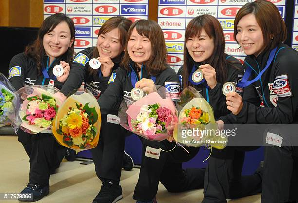 Japan Women's Curling team members Satsuki Fujisawa, Chinami Yoshida, Yuumi Suzuki, Yurika Yoshida and Mari Motohashi pose for photographs with their...