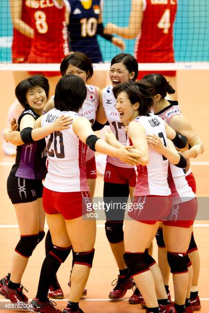 Japan Women's National Volleyball Team cheers for the winning in the FIVB World Grand Prix on August 17 2014 in Macau China