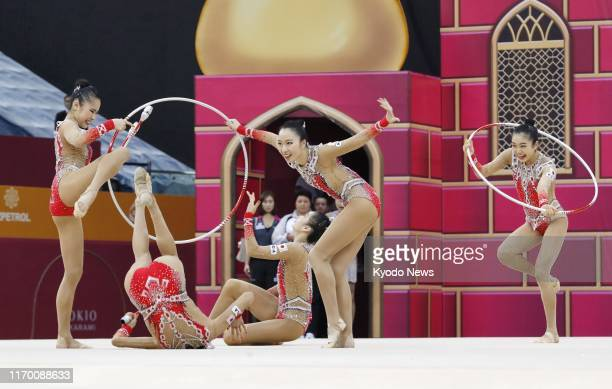 Japan women's rhythmic gymnastics team known as Fairy Japan performs in the hoops and clubs event in the team allaround competition at the world...