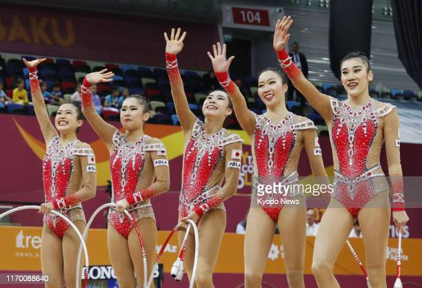 Japan women's rhythmic gymnastics team known as Fairy Japan acknowledges the crowd after completing their performance in the hoops and clubs event in...