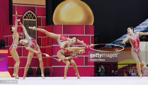 Japan women's rhythmic gymnastics team performs in the 3 hoops and 2 pairs of clubs final en route to winning silver at the world championships in...