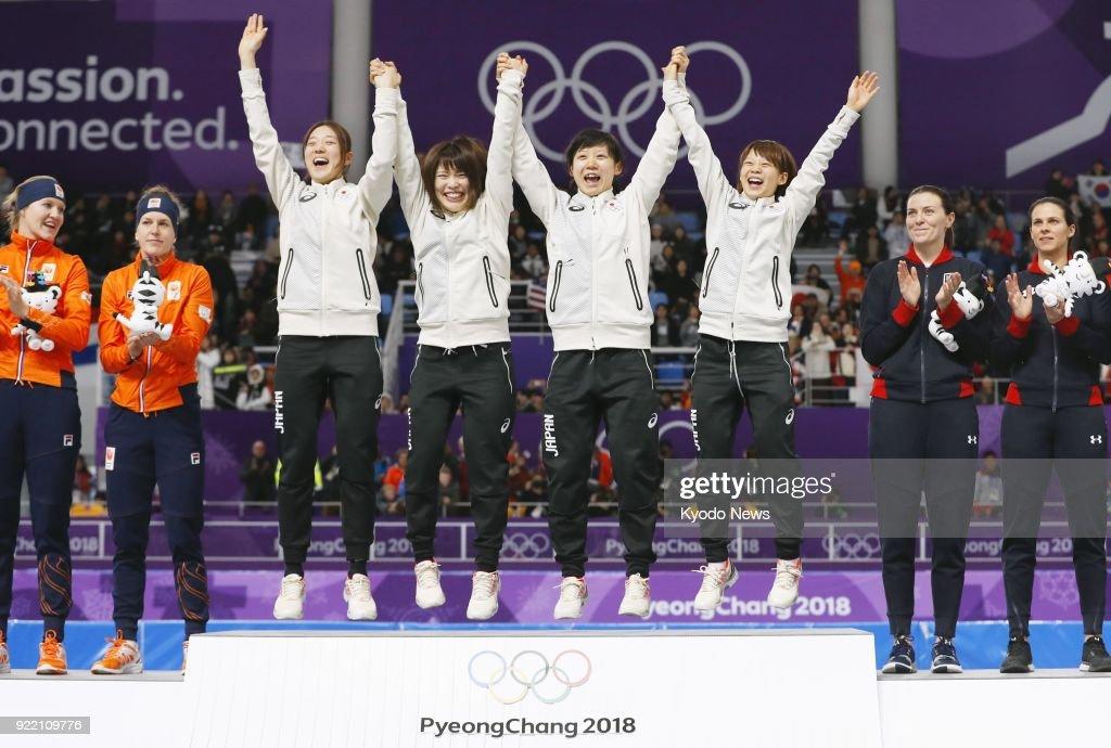 Japan women's speed skating team members (from L) Ayaka Kikuchi, Ayano Sato, Miho Takagi and Nana Takagi celebrate on the podium after winning the team pursuit gold medal in Gangneung, South Korea, at the Pyeongchang Winter Olympics on Feb. 21, 2018. ==Kyodo