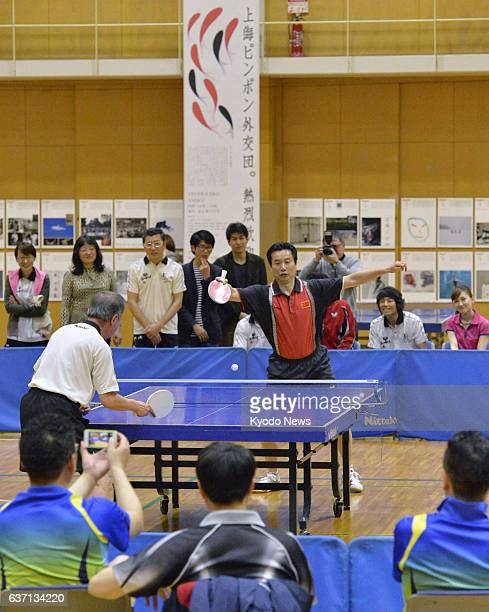 TOKYO Japan Wu Si Hai and Katsumi Asaba play in a friendly match of table tennis in Tokyo on May 6 to promote civil exchanges between Japan and China...