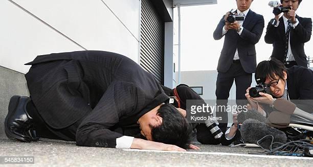 KANAZAWA Japan Yasuhiro Kanzaka president of Foods Forus Co prostrates himself in apology in front of the company's head office in Kanazawa Ishikawa...