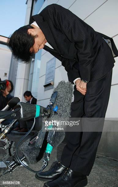 KANAZAWA Japan Yasuhiro Kanzaka president of Foods Forus Co the operator of the Yakinikuzakaya Ebisu chain bows in apology in front of the company's...