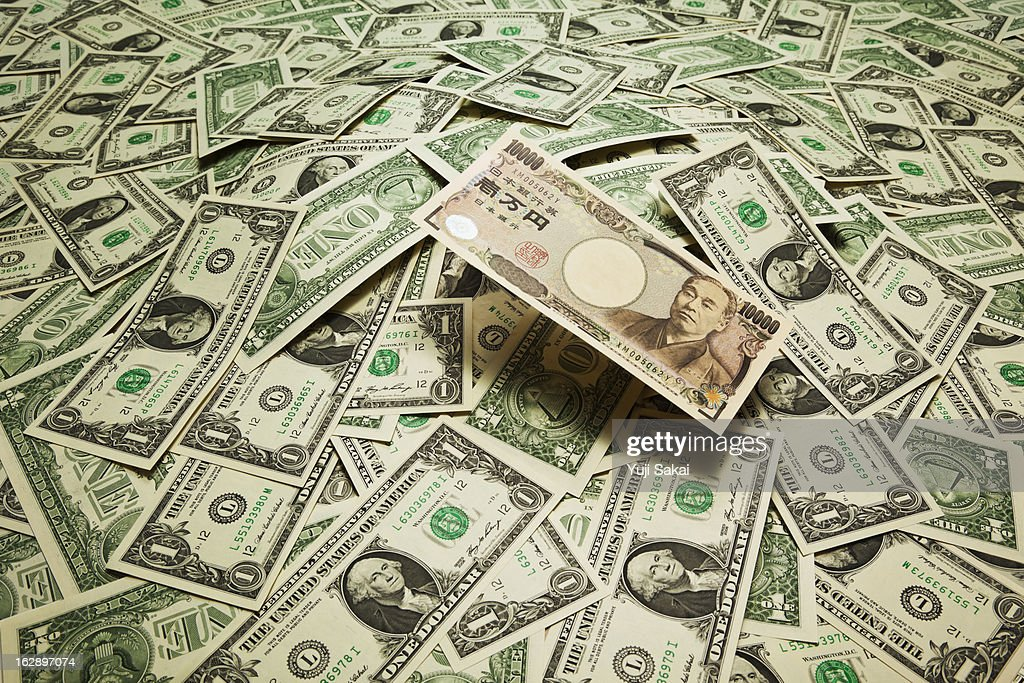 japan yen  on the  US dollar banknotes : Stock Photo