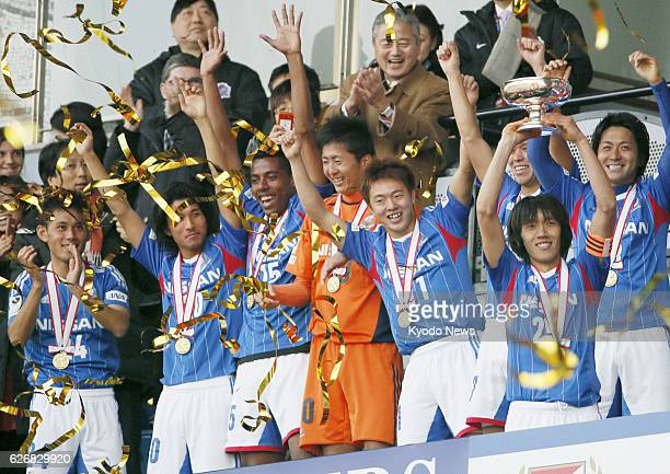 TOKYO Japan Yokohama F Marinos captain Shunsuke Nakamura holds the Emperor's Cup as players celebrate victory at National Stadium in Tokyo on Jan 1...