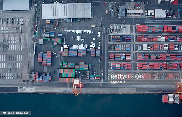 Japan, Yokohama, Kanagawa, Crane and cargo containers on pier, elevated view