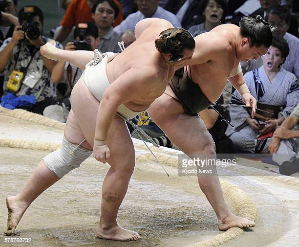 NAGOYA Japan Yokozuna Hakuho is forced out of the ring by ozeki Baruto by an overarm throw on July 24 the final day of the Nagoya Grand Sumo...