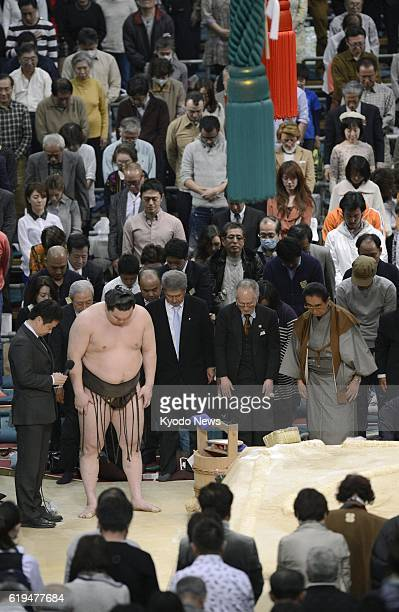OSAKA Japan Yokozuna Hakuho observes a moment of silence with the crowd for Taiho the most successful yokozuna in sumo who passed away in January...