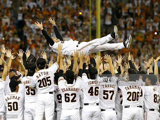 TOKYO Japan Yomiuri Giants players toss manager Tatsunori Hara into the air at Tokyo Dome in Tokyo on Sept 21 after winning their 34th Central League...