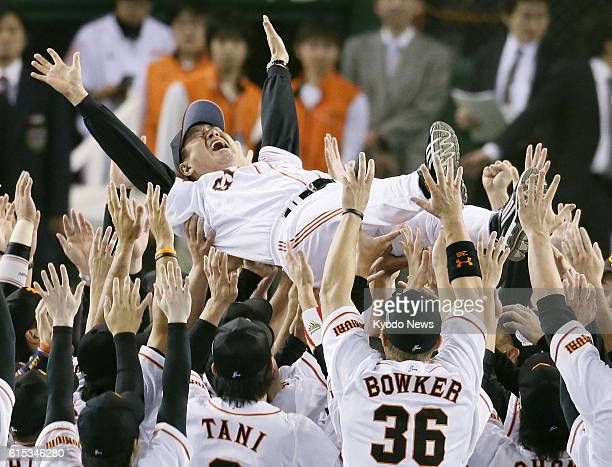 TOKYO Japan Yomiuri Giants players toss manager Tatsunori Hara into the air after edging the Nippon Ham Fighters 43 in Game 6 to claim their 22nd...