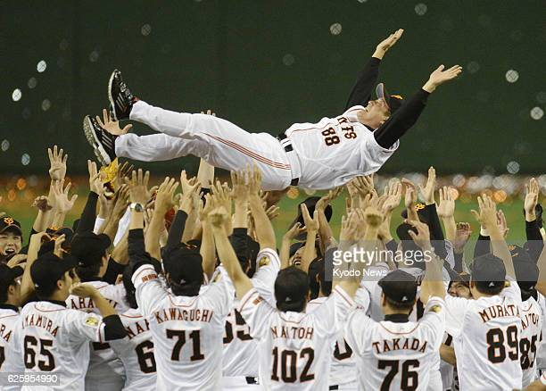 TOKYO Japan Yomiuri Giants players toss manager Tatsunori Hara into the air at Tokyo Dome in Tokyo on Sept 22 after winning their 35th Central League...