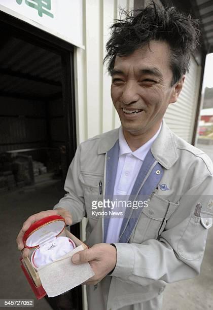 KAWAUCHI Japan Yoshiyuki Takeuchi an employee of the town of Okuma Fukushima Prefecture shows his wife's engagement ring in Kawauchi Fukushima on May...