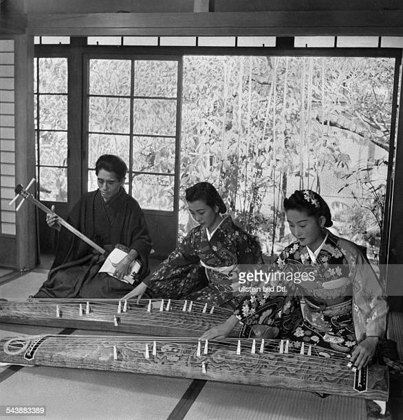 Japan young Japanese women learn to play the koto from Michio Miyagi the students play the koto and her blind master accompanies them on the shamisen...