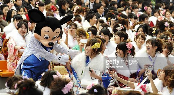 URAYASU Japan Young women in kimono and Mickey Mouse attend a comingofage ceremony at Tokyo Disneyland in Urayasu Chiba Prefecture on Jan 9 the...