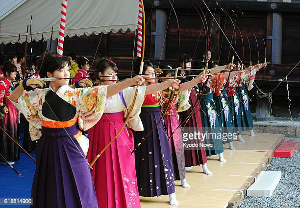 KYOTO Japan Young women who are or will turn 20 years old as of April 1 wearing traditional attire take aim in the 'Toshiya' archery event at...