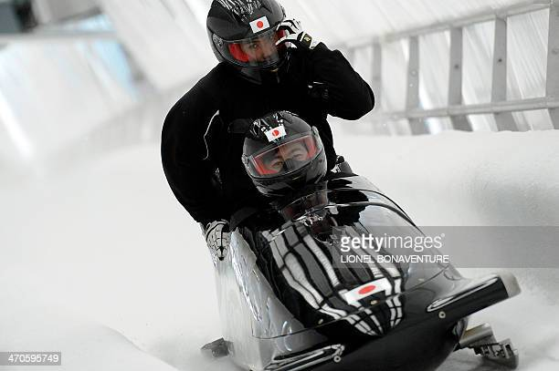 Japan-1 four-man bobsleigh, steered by Hiroshi Suzuki, take part in a training session at the Sanki Sliding Center in Rosa Khutor during the Sochi...