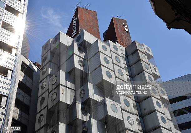 JapanarchitecturecapsuleNakaginFEATURE by Katie Forster This picture taken on September 13 2014 shows the Nakagin Capsule Tower in Tokyo The 140...