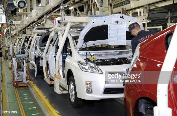 JapanautoenvironmentcompanyToyota by Kyoko Hasegawa This photo taken on June 5 2009 shows a factory worker assembling Prius hybrid vehicles along the...