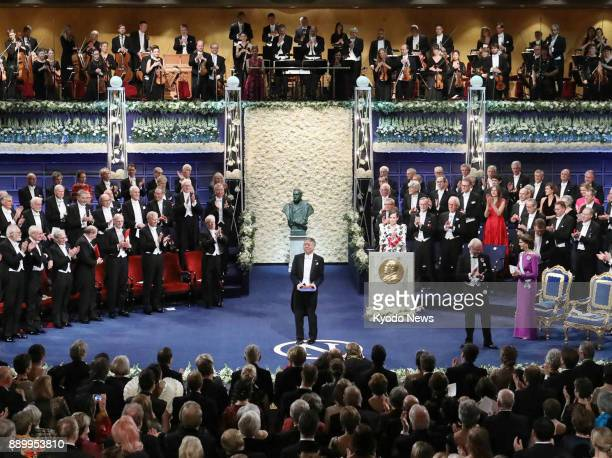 Japanborn British novelist Kazuo Ishiguro is applauded after receiving the 2017 Nobel Prize in literature on Dec 10 from Sweden's King Carl XVI...