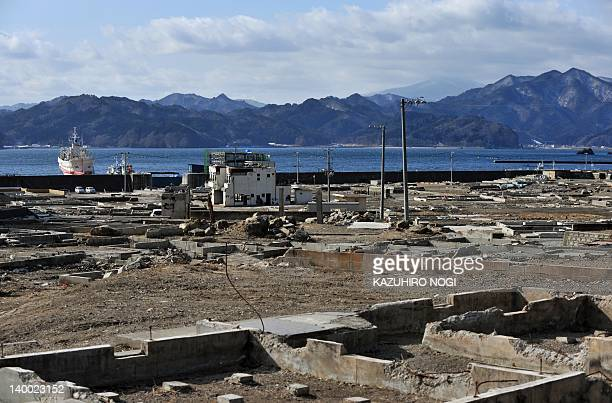 JapandisasteranniversaryreconstructionFOCUS by Shingo Ito This general view taken on February 13 2012 shows the tsunamihit area in Otsuchi Iwate...