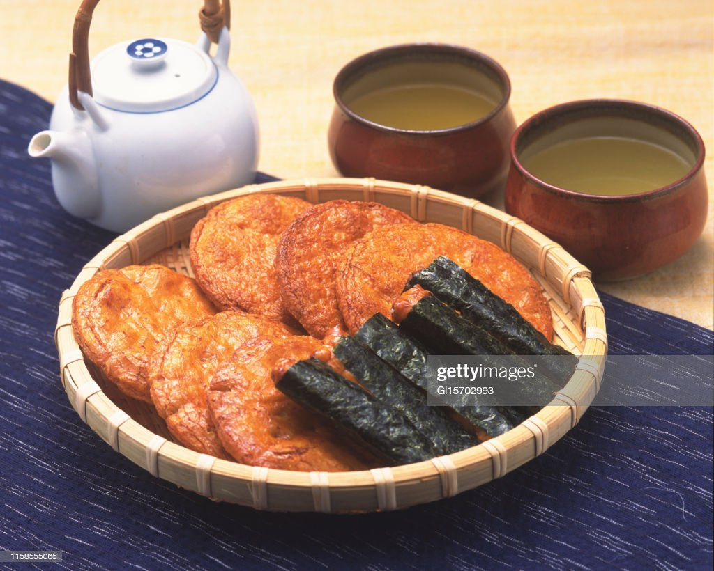Japanease crackers and green tea : Stock Photo