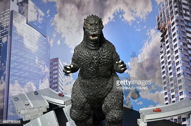 JapanentertainmentUSfilmGodzillaFEATURE by Miwa Suzuki This picture taken on May 4 2014 shows a onemetre tall statue of Godzilla at a Godzilla art...
