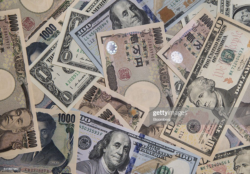 Japanese 10,000 yen and U.S. 100 dollar banknotes are arranged for a photograph in Tokyo, Japan, on Monday, June 20, 2016. Japanese shares fell, with the Topix index dropping for the first time in three days, as the yen rose ahead of the U.K. decision on European Union membership and investors awaited testimony from Federal Reserve Chair Janet Yellen. Photographer: Tomohiro Ohsumi/Bloomberg via Getty Images