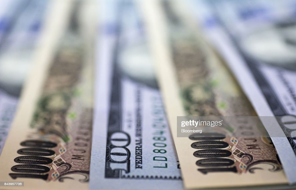 Japanese 10,000 yen and U.S. 100 dollar banknotes are arranged for a  photograph in Tokyo,