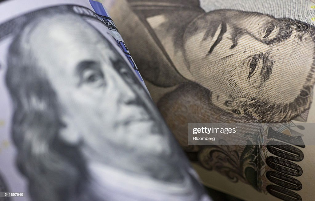 A Japanese 10,000 yen, right, and a U.S. 100 dollar banknotes are arranged for a photograph in Tokyo, Japan, on Monday, June 20, 2016. Japanese shares fell, with the Topix index dropping for the first time in three days, as the yen rose ahead of the U.K. decision on European Union membership and investors awaited testimony from Federal Reserve Chair Janet Yellen. Photographer: Tomohiro Ohsumi/Bloomberg via Getty Images