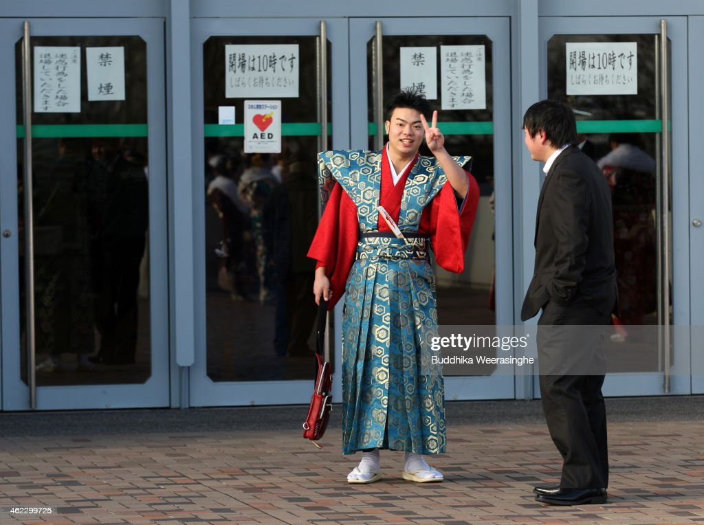 Japanese 20-year-old man dressed in traditional clothes poses for a photo during the Coming of Age Day ceremony at Cultural Hall on January 13, 2014 in Himeji, Japan. The Coming of Age Day is a Japanese holiday to congratulate and encourage young people who have reached the age 20 as maturity in Japan, when they are legally permitted to smoke, drink alcohol and vote.