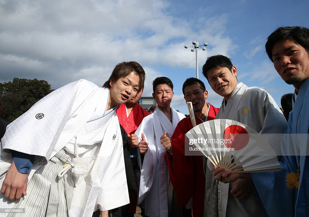 Japanese 20-year-old men dressed in traditional clothes pose for a photo during the Coming of Age Day ceremony at Cultural Hall on January 13, 2014 in Himeji, Japan. The Coming of Age Day is a Japanese holiday to congratulate and encourage young people who have reached the age 20 as maturity in Japan, when they are legally permitted to smoke, drink alcohol and vote.