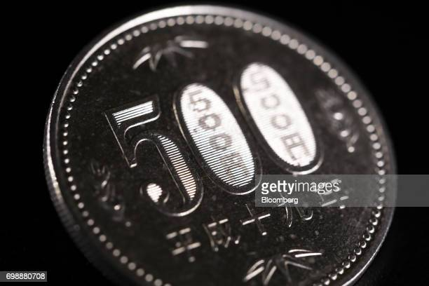A Japanese 500 yen coin is arranged for a photograph in Tokyo Japan on Tuesday June 20 2017 Japans Cabinet Office will release its monthly economic...