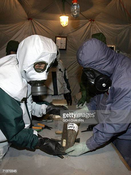 Japanese Abandoned Chemical Weapons expert together with his Chinese counterpart measure and identify one of the chemical bombs excavated from a site...