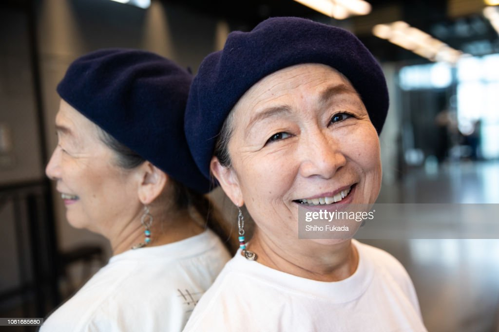 A Japanese active senior woman performs street-style dance in dance studio and street.