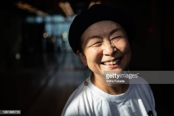 a japanese active senior woman performs street-style dance in dance studio and street. - 笑顔 ストックフォトと画像