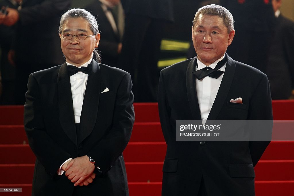 Japanese actor and director Takeshi Kitano (R) and Japanese producer Masayuki Mori arrive for the screening of 'Outrage' presented in competition at the 63rd Cannes Film Festival on May 17, 2010 in Cannes.