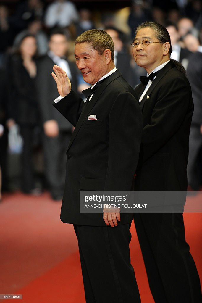 Japanese actor and director Takeshi Kitano and Japanese producer Masayuki Mori (R) arrive for the screening of 'Outrage' presented in competition at the 63rd Cannes Film Festival on May 17, 2010 in Cannes.