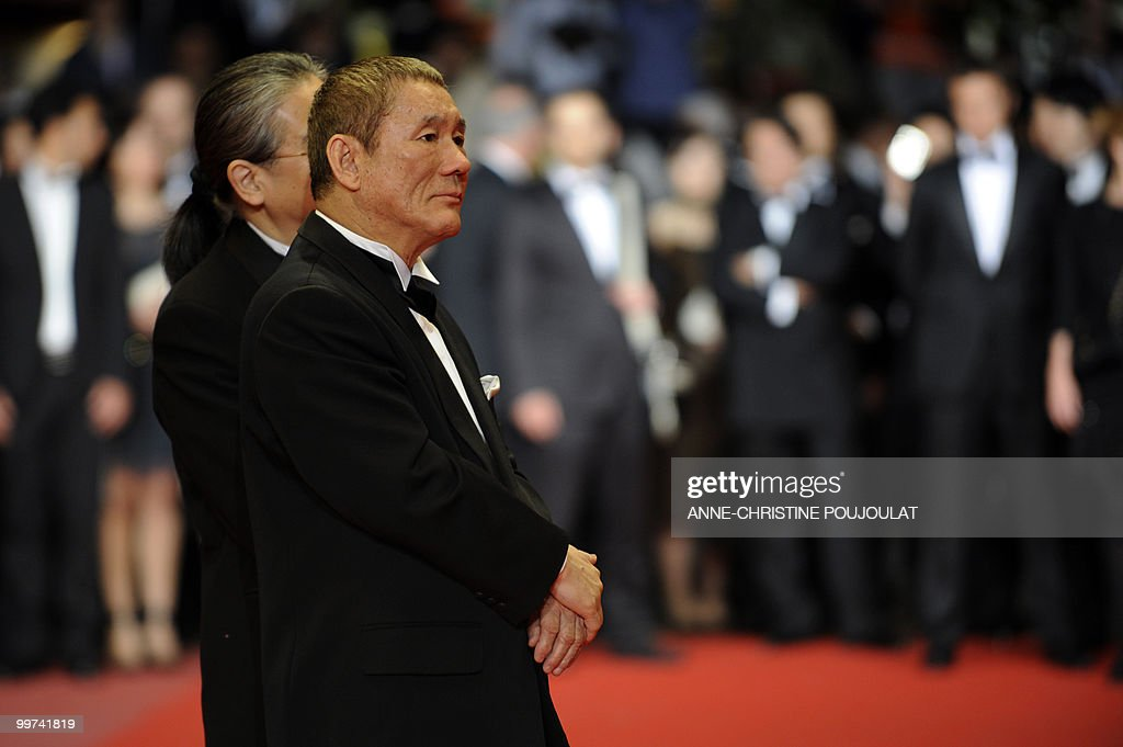 Japanese actor and director Takeshi Kitano and Japanese producer Masayuki Mori (L) arrive for the screening of 'Outrage' presented in competition at the 63rd Cannes Film Festival on May 17, 2010 in Cannes.