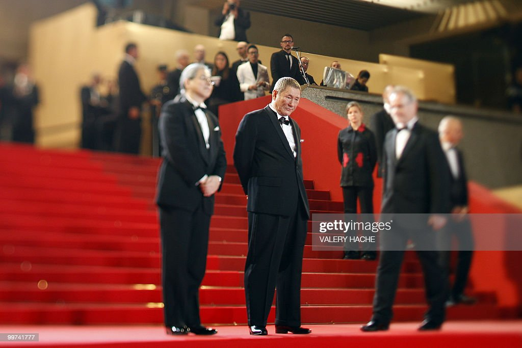 Japanese actor and director Takeshi Kitano arrive for the screening of 'Outrage' presented in competition at the 63rd Cannes Film Festival on May 17, 2010 in Cannes. Photo taken with a tilt and shift lens.