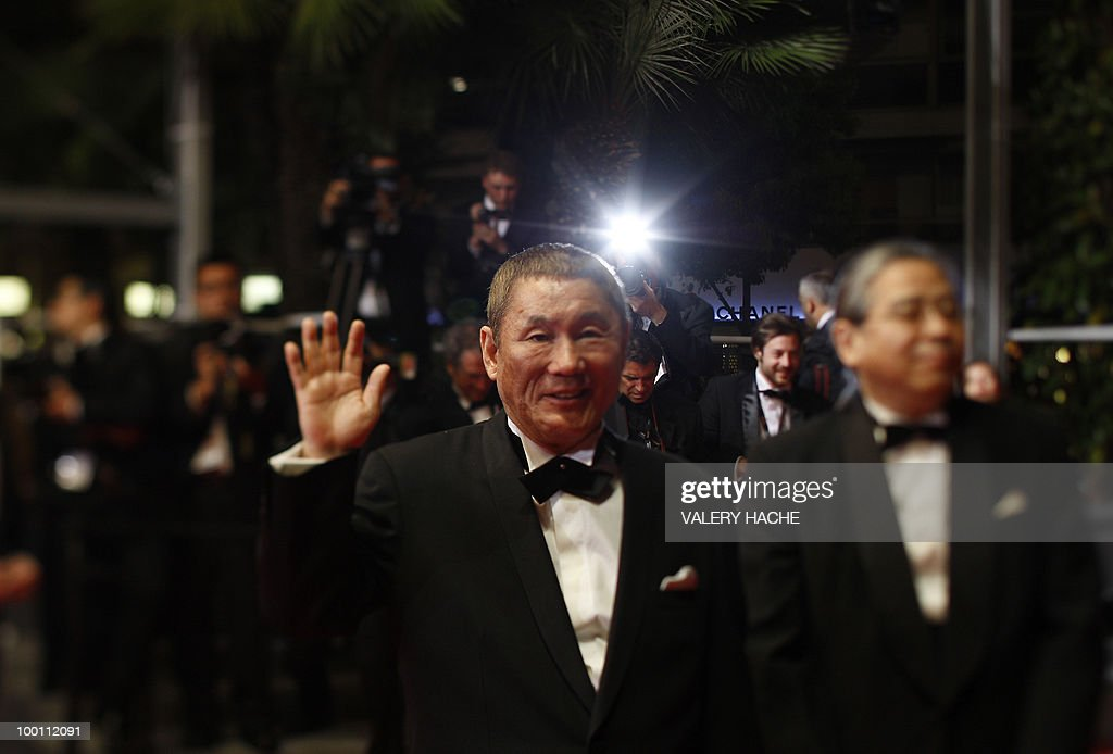 Japanese actor and director Takeshi Kitano arrives for the screening of 'Outrage' presented in competition at the 63rd Cannes Film Festival on May 17, 2010 in Cannes. Photo taken with a tilt and shift lens.