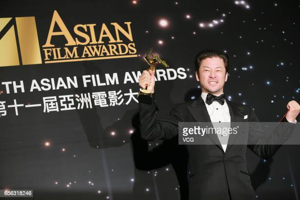Japanese actor and musician Tadanobu Asano winner of the Best Actor award for film 'Harmonium' celebrates at the backstage of the 11th Asian Film...