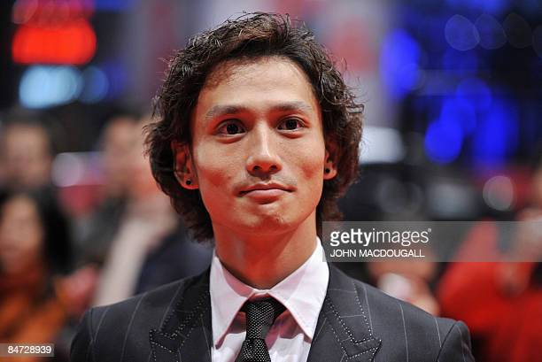 Japanese actor Ando Masanobu poses as he arrives for the screening of his film Forever enthralled presented in in competition at the 59th Berlinale...
