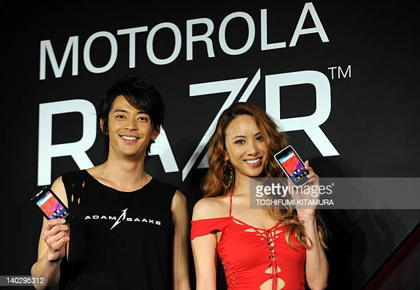 Japanese actor Atsushi and fashion model Angelica Michibata introduce Motorola's new smartphone 'Motorola Razr' in Tokyo on March 2 2012 The phone...