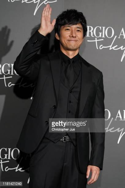 Japanese actor Hidetoshi Nishijima arrives at the Giorgio Armani 2020 Cruise Collection on May 24 2019 in Tokyo Japan