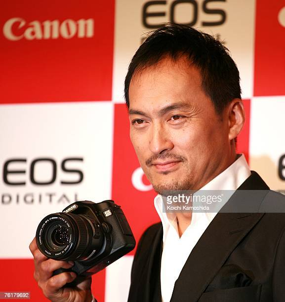 Japanese actor Ken Watanabe displays the new Canon EOS 40D digital SLR camera during a press preview on August 20, 2007 in Tokyo, Japan. The new...