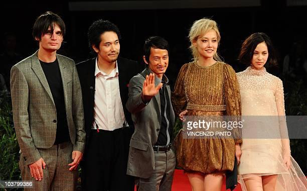 Japanese actor Kenichi Matsuyama Japanese actresses Rinko Kikuchi and Kiko Mizuhara and French film director Tran Anh Hung arrive for the screening...