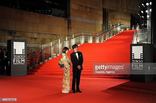 Japanese actor Koichi Sato and actress Tsubasa Honda pose as they attend the red carpet ceremony during the 28th Tokyo International Film Festival in...